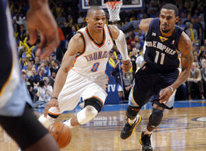 photo - Oklahoma City's Russell Westbrook (0) drive past Memphis' Mike Conley Jr. (11) during the NBA basketball game between the Oklahoma City Thunder and the Memphis Grizzlies at Chesapeake Energy Arena on Wednesday, Nov. 14, 2012, in Oklahoma City, Okla.   Photo by Chris Landsberger, The Oklahoman