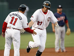 photo - MINOR LEAGUE BASEBALL: Oklahoma City's Mike Hessman (27) slaps the hand of manager Tony DeFrancesco (11) as he runs the bases after a home run in the second inning during the 2012 opening day baseball game between the Oklahoma City RedHawks and the Memphis Redbirds at the Chickasaw Bricktown Ballpark in Oklahoma City, Thursday, April 5, 2012. Photo by Nate Billings, The Oklahoman