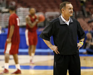 photo - Oklahoma coach Lon Kruger stands on the court as his players take shots during the practice and press conference day for the second round of the NCAA men's college basketball tournament at the Wells Fargo Center in Philadelphia, Thursday, March 21, 2013. OU will play San Diego State in the second round on Friday. Photo by Nate Billings, The Oklahoman