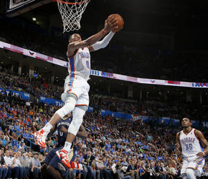 Photo - Oklahoma City's Russell Westbrook (0) goes to the basket during an NBA basketball game between the Oklahoma City Thunder and the New Orleans Pelicans at Chesapeake Energy Arena in Oklahoma City, Friday, April 11, 2014. Oklahoma City won 116-94. Photo by Bryan Terry, The Oklahoman