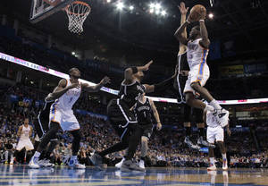 Photo - Thunder's Reggie Jackson (15) drives in the first half of an NBA basketball game where the Oklahoma City Thunder were defeated 95-93 by the Brooklyn Nets at the Chesapeake Energy Arena in Oklahoma City, on Thursday, Jan. 2, 2014. Photo by Steve Sisney The Oklahoman