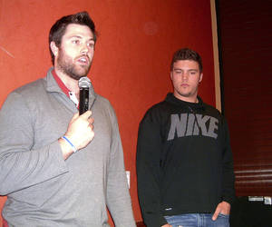 photo - University of Oklahoma football players Gabe Ikard, left, and Blake Bell talk to young men attending the  Catholic Men's Conference on Feb. 16 in Norman.  Photos by Steve Gust for The Oklahoman