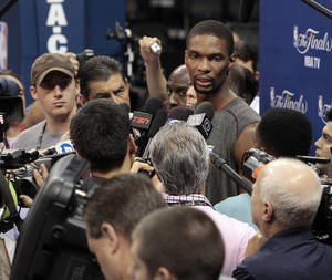 Photo - Miami Heat power forward Chris Bosh talks with the media before practice in preparation for game two of the NBA basketball finals at the Chesapeake Arena on Wednesday, June 13, 2012 in Oklahoma City, Okla.  Photo by Steve Sisney, The Oklahoman