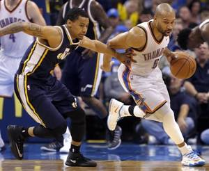 Photo - Oklahoma City 's Derek Fisher (6) drives up court as Utah's Trey Burke (3) defends after a turnover during the NBA game between the Oklahoma City Thunder and the Utah Jazz at the Chesapeake Energy Arena, Sunday, March 30, 2014, in Oklahoma City. Photo by Sarah Phipps, The Oklahoman