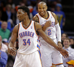 Photo - Oklahoma City's Hasheem Thabeet (34) and Caron Butler (2) celebrate after Thabeet made a basket during an NBA basketball game between the Oklahoma City Thunder and the Philadelphia 76ers at Chesapeake Energy Arena in Oklahoma City, Tuesday, March 4, 2014. Oklahoma City won 125-92.  Photo by Bryan Terry, The Oklahoman