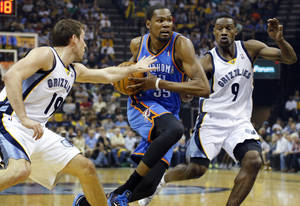 Photo - Oklahoma City's Kevin Durant (35) drives between Memphis' Beno Udrih (19) and Tony Allen (9) during Game 4 in the first round of the NBA playoffs between the Oklahoma City Thunder and the Memphis Grizzlies at FedExForum in Memphis, Tenn., Saturday, April 26, 2014. Photo by Bryan Terry, The Oklahoman
