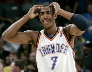 Photo - Oklahoma City's Kevin Ollie reacts to an official's call during the NBA basketball game between the Los Angeles Lakers and the Oklahoma City Thunder at the Ford Center in Oklahoma City, on Tuesday, Nov. 3, 2009. The Thunder lost to the Lakers  By John Clanton, The Oklahoman