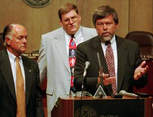 Photo - Former Mayor Ron Norick (left) and Clay Bennett (center) listen to Rick Horrow of Horrow Sports Ventures talk about the attempts of a private citizens' group to attract an NHL or NBA franchise at a 1995 press conference.  <strong>ROGER KLOCK</strong>