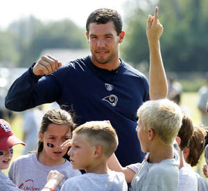 photo - Sam Bradford works with campers during his football camp on the campus of the University of Oklahoma on Tuesday, July 10, 2012, in Norman, Okla. Photo by Steve Sisney, The Oklahoman <strong>STEVE SISNEY</strong>