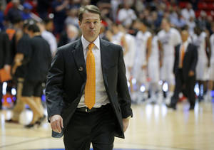 Photo -  OSU coach Travis Ford walks off the court after losing to Gonzaga in the Cowboys' first game of the NCAA Tournament in late March. PHOTO BY BRYAN TERRY, The Oklahoman  <strong>BRYAN TERRY -   </strong>