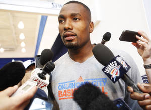 Photo - Thunder forward Serge Ibaka speaks to the media after practice at the Thunder Practice Facility in Oklahoma City on Monday, April 26, 2014. Photo by KT King/The Oklahoman