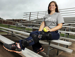 Photo - UCO softball player Kacie Edwards (22) poses for a photo at the University Central Oklahoma softball field in Edmond, Okla., Monday, May 7, 2012. Edwards hit a home run and a 2-run single during a game on Sunday with a torn ACL. Photo by Nate Billings, The Oklahoman