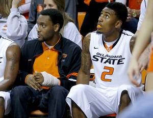 photo - OSU: Oklahoma State's Le'Bryan Nash (2) and Brian Williams sit on the bench during the final minutes of a college basketball game between Oklahoma State University and UT Arlington at Gallagher-Iba Arena in Stillwater, Okla., Wednesday, Dec. 19, 2012. Photo by Bryan Terry, The Oklahoman