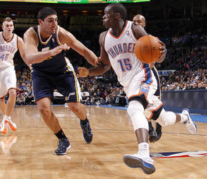 Photo - NBA BASKETBALL: Oklahoma City's Reggie Jackson (15) goes past Utah's Enes Kanter (0)during an NBA game between the Oklahoma City Thunder and the Utah Jazz at Chesapeake Energy Arena in Oklahoma CIty, Tuesday, Feb. 14, 2012. Photo by Bryan Terry, The Oklahoman