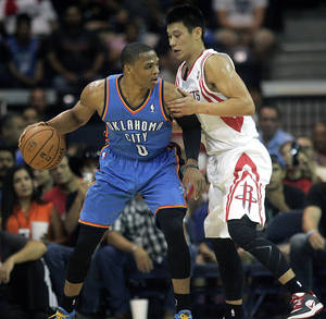 photo - Houston Rockets' Jeremy Lin defends Oklahoma City Thunder's Russell Westbrook (0) during the second quarter of an NBA preseason basketball game, Wednesday, Oct. 10, 2012, in Hidalgo, Texas. The Thunder won 107-103. (AP Photo/Delcia Lopez) ORG XMIT: TXDL112