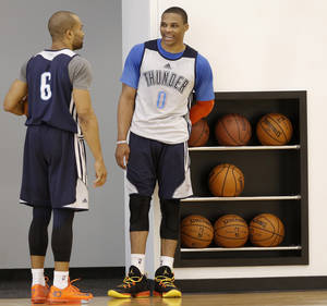 Photo - Derek Fisher, left, and Russell Westbrook talk during a Thunder practice on Wednesday. Westbrook participated in his first full practice Wednesday, according to Thunder coach Scott Brooks, and is now believed to be a game-time decision for Thursday's game against Miami.  Photo by Doug Hoke,  The Oklahoman
