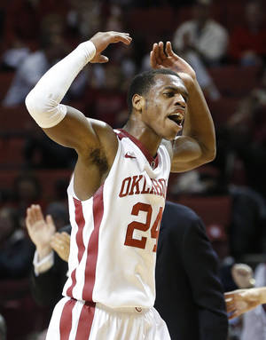 Photo - Oklahoma guard Buddy Hield celebrates during the second half of an NCAA college basketball game against TCU in Norman, Okla., Wednesday, Jan. 22, 2014. Oklahoma won 77-69. (AP Photo/Sue Ogrocki)