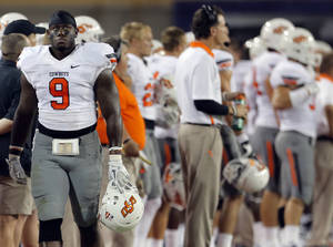 photo - Oklahoma State's Kye Staley (9) reacts on the sidelines during the college football game between the University  of Arizona and Oklahoma State University at Arizona Stadium in Tucson, Ariz.,  Sunday, Sept. 9, 2012. Photo by Sarah Phipps, The Oklahoman