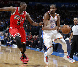 photo - Oklahoma City&#039;s Kevin Durant (35) tries to get past Chicago&#039;s Luol Deng (9) during the NBA game between the Oklahoma City Thunder and the Chicago Bulls at Chesapeake Energy Arena in Oklahoma City, Saturday, Feb. 23, 2013. Photo by Sarah Phipps, The Oklahoman