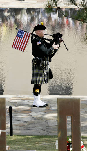 photo - Pipe Sgt. Kevin M. Donnelly plays for the 15th anniversary of the Oklahoma City bombing.  PHOTO BY PAUL B. SOUTHERLAND, THE OKLAHOMAN ARCHIVES