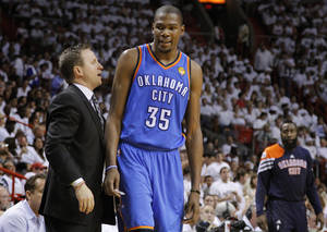 photo - Oklahoma City's Kevin Durant (35) talks with coach Scott Brooks on his way to the bench after picking up his fifth foul during Game 3 of the NBA Finals between the Oklahoma City Thunder and the Miami Heat at American Airlines Arena, Sunday, June 17, 2012. Photo by Bryan Terry, The Oklahoman