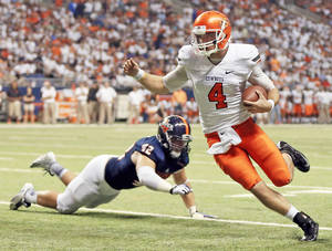 Photo - OSU quarterback J.W. Walsh (4) carries the ball past UTSA's Jens Jeters (42) on his way to a touchdown in the second quarter during a college football game between the University of Texas at San Antonio Roadrunners (UTSA) and the Oklahoma State University Cowboys (OSU) at the Alamodome in San Antonio, Saturday, Sept. 7, 2013.  Photo by Nate Billings, The Oklahoman