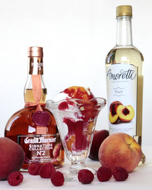 Photo - Sherrel uses cognac to make Peach Melba. PHOTO BY DAVID MCDANIEL, THE OKLAHOMAN <strong>David McDaniel</strong>