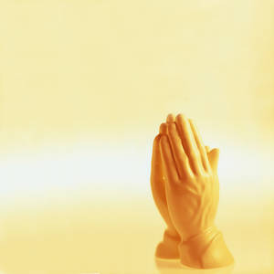 Photo - Praying hands statue