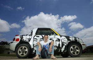 photo - Drew Hooper sits Wednesday near his car, on which he has painted the faces of Thunder players. Faces from left: Kendrick Perkins, Kevin Durant, James Harden, Derek Fisher, Nick Collison and Cole Aldrich. Photo by Doug Hoke, The Oklahoman