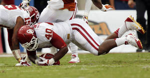 Photo - OU's P.L. Lindley (40) falls on a Texas fumble in the first quarter during the Red River Rivalry college football game between the University of Oklahoma Sooners and the University of Texas Longhorns at the Cotton Bowl Stadium in Dallas, Saturday, Oct. 12, 2013. Photo by Nate Billings, The Oklahoman