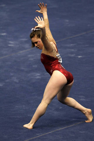 Oklahoma's Chayse Capps competes in the floor exercise during the NCAA women's gymnastics championships Friday, April 18, 2014, in Birmingham, Ala. (AP Photo/Butch Dill)