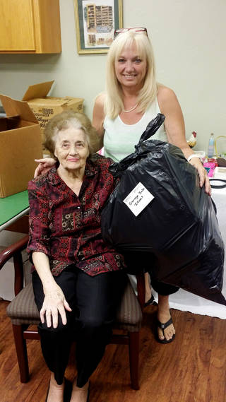 Grace Living Center Bethany resident Pat Lee, 75, helped Activities Director Andrea Anfuso sort through items donated for the home's annual yard sale. PHOTO PROVIDED PROVIDED