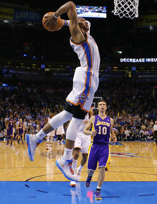 Oklahoma City's Russell Westbrook (0) goes up for a dunk as Los Angeles' Steve Nash (10) watches during an NBA basketball game between the Oklahoma City Thunder and the Los Angeles Lakers at Chesapeake Energy Arena in Oklahoma City, Tuesday, March. 5, 2013. Photo by Bryan Terry, The Oklahoman
