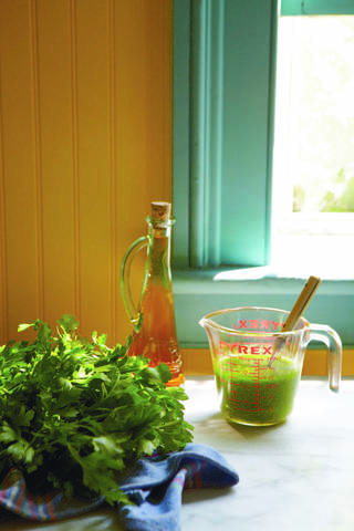 "A parsley-packed vinaigrette makes a tasty dressing for salads and lightly steamed vegetables. (Photo by Colin Clark for ""Hero Food"" by Seamus Mullen, Andrews McMeel, 2012.)"