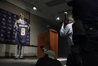 St. Louis Rams quarterback Sam Bradford poses for photographs with his new jersey during an NFL football news conference on Friday, April 23, 2010, at the Rams' training facility in St. Louis. Bradford was selected as the No. 1 overall pick by the Rams in the first round of the draft. (AP Photo/Jeff Roberson) ORG XMIT: MOJR109