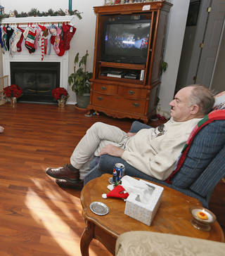 Bob Simmers sits in the common room at Green Acres. NATE BILLINGS - The Oklahoman