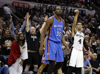 Oklahoma City's Kevin Durant (35) and San Antonio's Danny Green (4) watch a Green 3-point shot go in as fans celebrate during Game 5 of the Western Conference Finals in the NBA playoffs between the Oklahoma City Thunder and the San Antonio Spurs at the AT&T Center in San Antonio, Thursday, May 29, 2014. Photo by Sarah Phipps, The Oklahoman