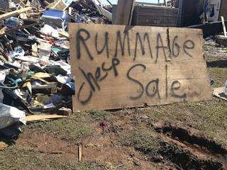 "Tom Bridges' house was destroyed in Moore on Monday, May 20. He put a sign up that said ""Rummage sale-cheap"" to get 'A laugh out of all this mess. We need that,"" the Army veteran, 68, said. The sign drew attention from passers-by."