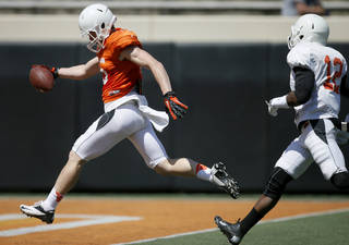 OSU's Bake Webb scores a touchdown in front of Elliott Jeffcoat during Oklahoma State's Orange Blitz football practice at Boone Pickens Stadium in Stillwater, Okla., Saturday, April 5, 2014.