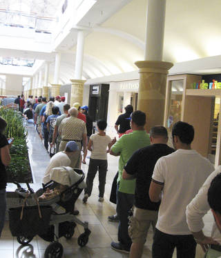 Customers line the halls of Penn Square Mall in Oklahoma City to get to the Apple Store to buy a new iPhone 5. Most were able to make their puchase within about three hours. DON MECOY - THE OKLAOMAN