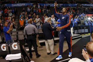 Oklahoma City 's Kevin Durant takes the court before an NBA preseason game between the Oklahoma City Thunder and the Denver Nuggets at Chesapeake Energy Arena on Tuesday, october 15, 2013. Tuesday, Oct. 15, 2013. Photo by Bryan Terry, The Oklahoman