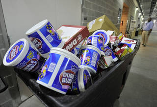 A garbage bin sits full of bubble gum at Yankee Stadium in New York. U.S. gum sales tumbled 11 percent over the past four years. AP Photo Kathy Kmonicek - AP