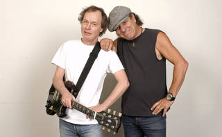 FILE - In this Sept. 9, 2008 file photo, Angus Young, left, and Brian Johnson of AC/DC are photographed in New York. As part of the biggest and most enduring bands in the world, Young and Johnson believe that early struggles got them to where they are today. (AP Photo/Jim Cooper, file)