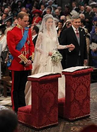 Prince William and Kate Middleton stand at the altar with Kate's father Michael Middleton inside Westminster Abbey where the couple will marry Friday April, 29, 2011. (AP Photo/Dominic Lipinski/Pool)