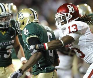 Sooner Marcus Trice (13) catches return man Ahmad Dixon (6) and causes a fumble through the end zone for a touchback during the second half of the college football game between the University of Oklahoma Sooners (OU) and the Baylor Bears (BU) at Floyd Casey Stadium on Saturday, November 20, 2010, in Waco, Texas. Photo by Steve Sisney, The Oklahoman STEVE SISNEY