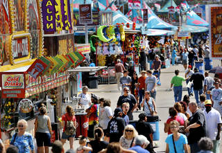 Crowds along the midway and food row area at the Oklahoma State Fair on Wednesday, Sep. 18, 2013. Photo by Jim Beckel, The Oklahoman.