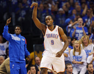 Oklahoma City's Serge Ibaka (9) reacts after hitting a shot in the first half during Game 4 of the Western Conference Finals between the Oklahoma City Thunder and the San Antonio Spurs in the NBA playoffs at the Chesapeake Energy Arena in Oklahoma City, Saturday, June 2, 2012. Photo by Nate Billings, The Oklahoman