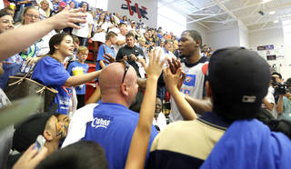 Oklahoma City's Kevin Durant (35) greets fans following the Oklahoma City Thunder's Blue and White scrimmage at Westmoore High School in Moore, Okla., Sunday, Oct. 13, 2013. Photo by Sarah Phipps, The Oklahoman
