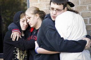 Samantha Ritz, Marissa Hutton, Daniel Flynn and Stephanie Spehar gather to support each other during a vigil for Carina Saunders, whose body was found in a duffel bag last week, on Tuesday, Oct. 18, 2011. in Bethany, Okla. Photo by Chris Landsberger, The Oklahoman ORG XMIT: KOD