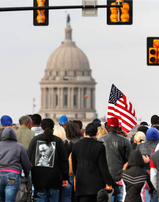 About 100 men, women and children participated in the Silent March, walking from the Freedom Center on N. Martin Luther King Avenue. then west on NE 23 Street to the Oklahoma History Center for speeches and a bell ringing ceremony; the march and bell ringing ceremony were among events in the Oklahoma City area that allowed local residents to observe the national holiday honoring slain civil rights leader, Dr. Rev. Martin Luther King, Jr. on Monday, Jan. 16, 2012, Photo by Jim Beckel, The Oklahoman